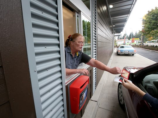 Kathy Silverman works the drive-thru window for the