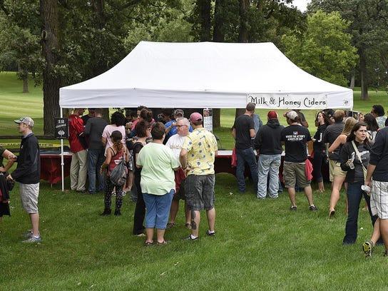 People line up for samples during the inaugural Ciderfest