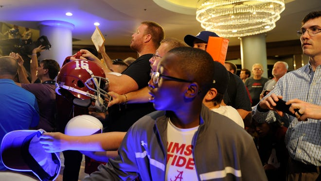 Alabama fans react to Alabama head coach Nick Saban walking through at SEC Media Days at The Wynfrey Hotel in Hoover, Ala. on Wednesday, July 12, 2017.