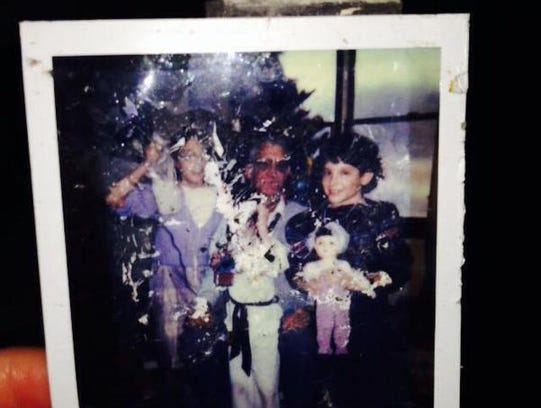 A photo of Cori Faklaris (left), her grandfather Dutch Bockler, and her sister Kate Pinnow during a childhood Christmas. The photo was found and posted on Facebook by Amanda Everett-Ritter in Plainfield, Ill., nearly 100 miles from where a tornado demolished the Faklaris family home in Washington, Ill.