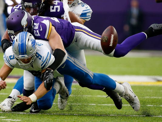 """FILE - In this Oct. 1, 2017, file photo, Detroit Lions quarterback Matthew Stafford (9) fumbles as he is hit by Minnesota Vikings free safety Harrison Smith (22) during the second half of an NFL football game in Minneapolis. No team in the NFL this season allowed fewer yards or fewer points than the Vikings, which means no team in the playoffs is better suited to make true the """"defense wins championships"""" mantra than them.  (AP Photo/Bruce Kluckhohn, File)"""
