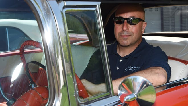 Kenny Pascoe, a Town of Poughkeepsie resident and collector of muscle and classic cars. He's sitting here in a 1955 Chevy Bel Air convertible.