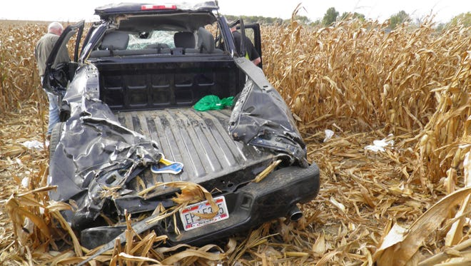 The wreckage of a pickup truck that crashed in a cornfield near Upper Sandusky, Ohio, on Oct. 12, 2014, killing Andrew Bloomfield and seriously injuring his wife.