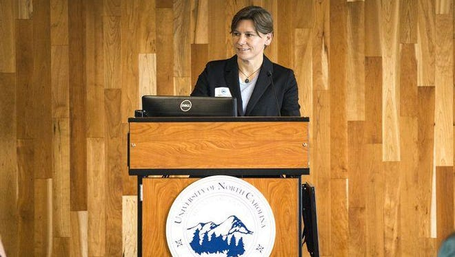 Tammy Hooper speaks during the City of Asheville police chief candidate presentation at UNC Asheville's Sherrill Center in May.