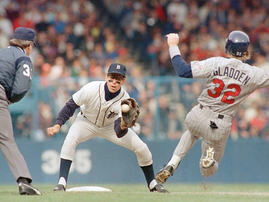 FILE - In this Saturday, Oct. 10, 1987  file photo, Minnesota Twins Dan Gladden (32) prepares to slide into second as Detroit Tigers shortstop Alan Trammell reaches for the throw from the catcher for the third out in the first inning in Detroit. Jeff Bagwell, Tim Raines and Trevor Hoffman fell just short of election to baseball Hall of Fame; Alan Trammell, Mark McGwire missed in their final chance, Wednesday, Jan. 6, 2016. (AP Photo/Peter Southwick, File)