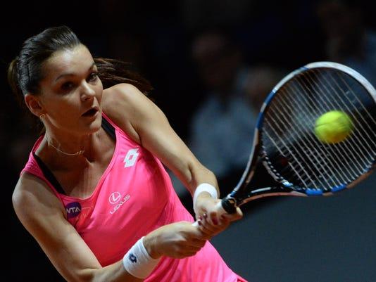 Agnieszka Radwanska from Poland returns a ball to Laura Siegemund from Germany during their semifinals at the WTAtournament in Stuttgart, Germany, Saturday, April 23, 2016. (Marijan Murat/dpa via AP)