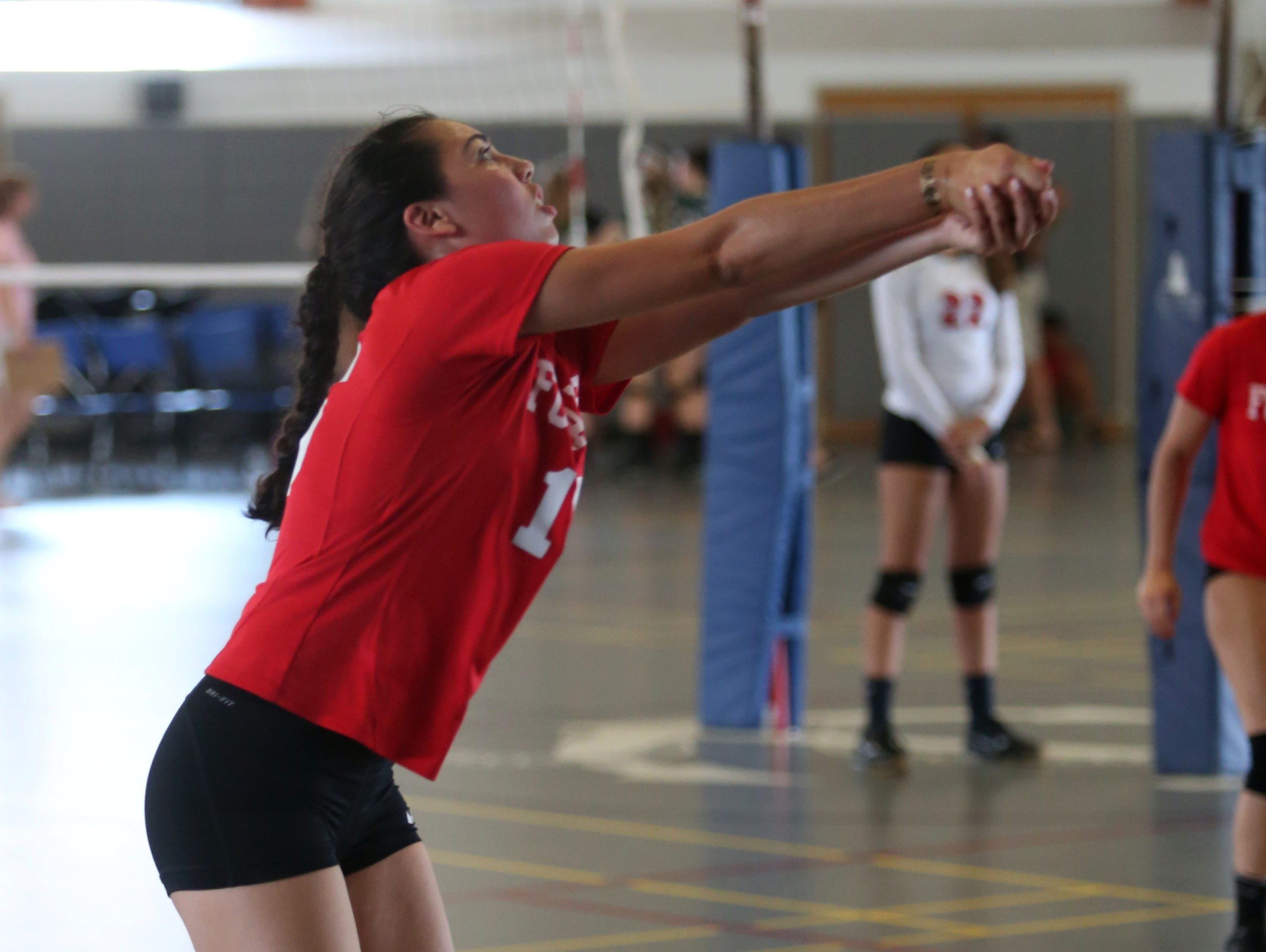 Caroline Scanlan with the Fox Lane High School Volleyball team, returns a shot against Millbrook during the Breast Cancer Awareness tournament at Hendrick Hudson High School in Montrose, Sept, 10, 2016.