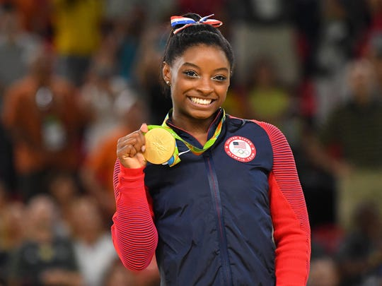 Simone Biles celebrates after winning a gold medal during to the women's floor exercise final in the Rio 2016 Summer Olympic Games at Rio Olympic Arena. Credit: Robert Deutsch-USA TODAY Sports