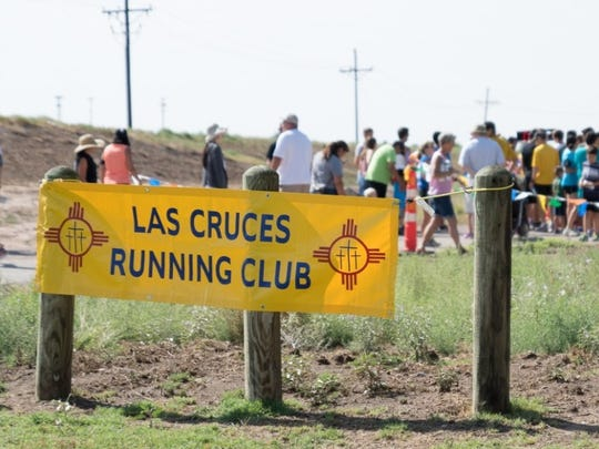 Participants gather for the summer youth running program 1-mile summer challenge series at La Llorona Park in July 2015.