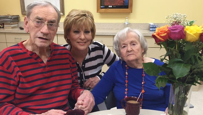 Martie Salt with her parents at an assisted living facility.