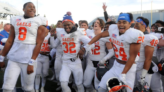 Bishop Gorman players celebrate after defeating Reed for the Nevada State 4A Football Championship at Mackay Stadium in Reno on Dec. 2, 2017.