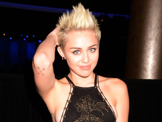 We all got Miley'd in 2013. The sassy pop star kicked off the year showing off some side cleavage at Clive Davis' Grammys gala at The Beverly Hilton Hotel on Feb. 9. And she went on to become the subject of endless chatter, thanks to her VMAs appearance, her 'SNL' gig and her ever-more-edgy outfits. USA TODAY's Ann Oldenburg offers a reminder of her crazy year and many looks.
