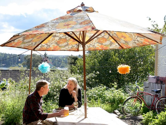 Rick Hawkins and Carol Appenzeller, of Bainbridge Island, dine outside during Mossback restaurant's monthly El Musgo taco stand popup.