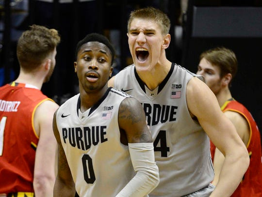 Jan 10, 2015; West Lafayette, IN, USA; Purdue Boilermakers center Isaac Haas (44) celebrates a shot made by guard Jon Octeus (0) during the first half of the game against the Maryland Terrapins at Mackey Arena. Mandatory Credit: Marc Lebryk-USA TODAY Sports