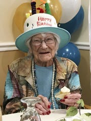 Hazel Nilson celebrates her 111th birthday with a peach cupcake on Wednesday in Sunapee, N.H. A lifelong Chicago Cubs fan, Nilson was born on Aug. 21, 1908, in Chicago.
