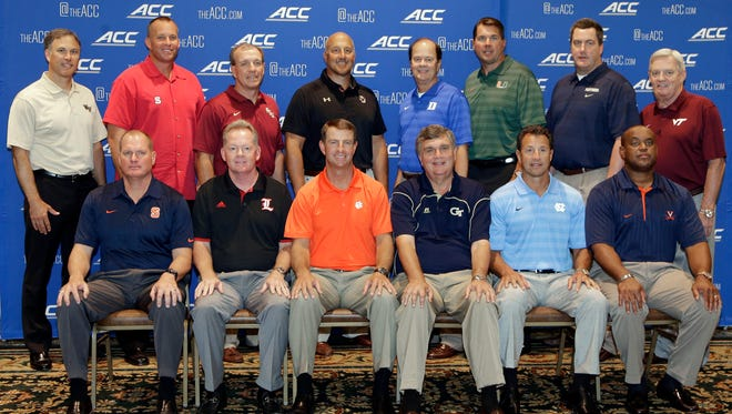 Atlantic Coast Conference football coaches pose for a group photo during the ACC Football kickoff in Greensboro, N.C., Monday, July 21, 2014. The coaches are, back row from left: Wake Forest's Dave Clawson, North Carolina State's Dave Doeren, Florida State's Jimbo Fisher, Boston College's Steve Addazio, Duke's David Cutcliffe, Miami's Al Golden, Pittsburgh's Paul Chryst, and Virginia Tech's Frank Beamer. Front row, from left are: Syracuse's Scott Shafer, Louisville's Bobby Petrino, Clemson's Dabo Swinney, Georgia Tech's Paul Johnson, North Carolina's Larry Fedora, and Virginia's Mike London.(AP Photo/Chuck Burton)