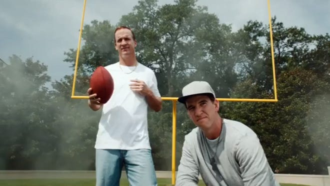 Peyton and Eli Manning have graduated from 'Football on Your Phone.'