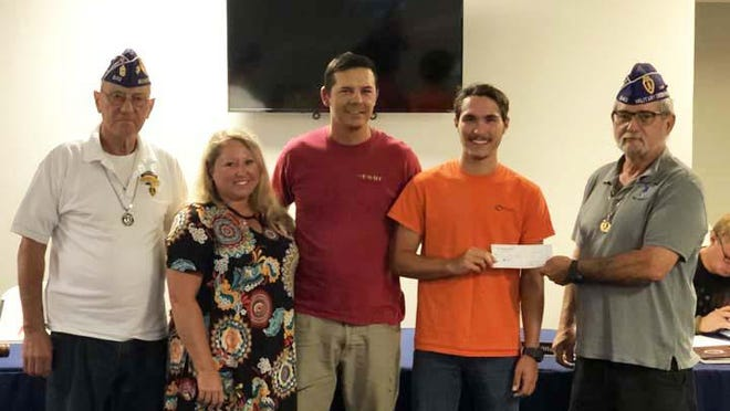 Beirut Memorial Chapter 642 MOPH recently presented a $1,500 scholarship to Christian Greene who plans on attending UNC-Greensboro. He is pictured with Cmdr. Houle, Mr. and Mrs. Greene and Stan Walker.