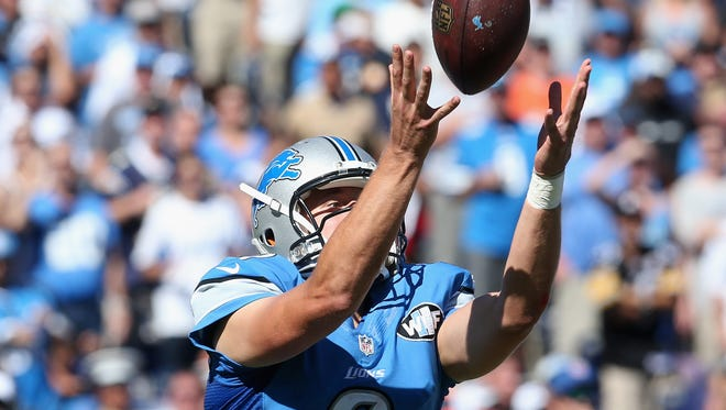 Lions quarterback Matthew Stafford reaches for a botched snap against the Chargers at Qualcomm Stadium on Sunday.