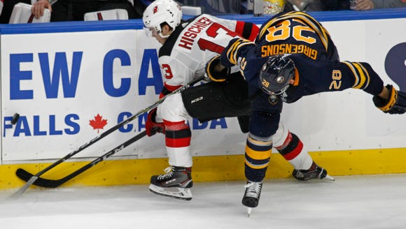 Buffalo Sabres Zemgus Girgensons (28) and New Jersey