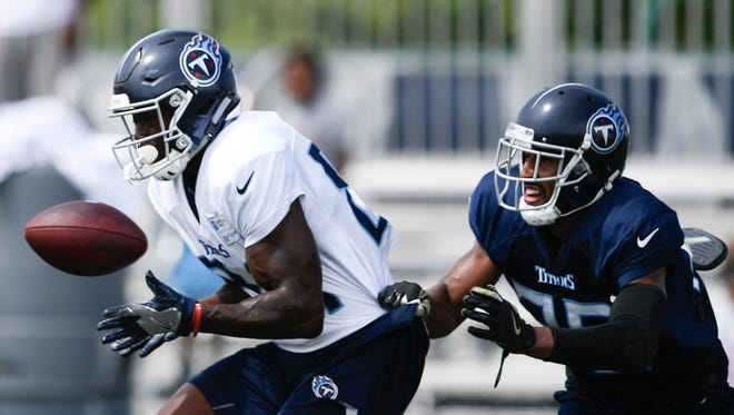Titans wide receiver Corey Davis (84) pulls in a pass over cornerback Logan Ryan (26) during practice at Saint Thomas Sports Park Wednesday, Aug. 1, 2018, in Nashville, Tenn.