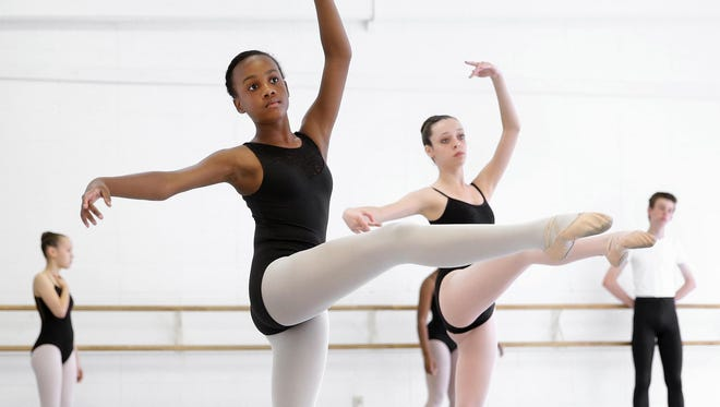 Sydney Williams, 12, works on her technique during her class at the Indianapolis School of Ballet on June 16.
