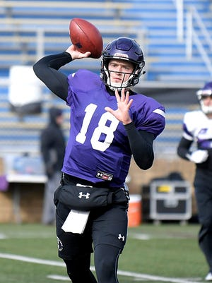Northwestern University quarterback Clayton Thorson (#18) practices throwing to teammates at John Paul II High School in Hendersonville on Tuesday, Dec. 26, 2017. Northwestern University and University of Kentucky play each other in the Music City Bowl.