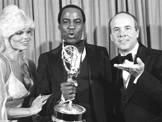 Robert Guillaume, center, shows off his 1979 Emmy