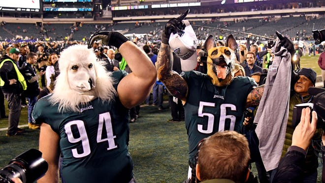 Philadelphia Eagles defensive tackle Beau Allen (94) and defensive end Chris Long (56) celebrate after beating the Minnesota Vikings in the NFC Championship game at Lincoln Financial Field.