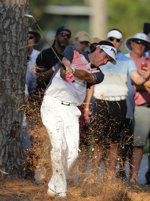 PONTE VEDRA BEACH, FLORIDA - MAY 11: Bubba Watson of the USA plays a shot from the pine straw on the 18th hole during the second round of THE PLAYERS Championship on the Stadium Course at TPC Sawgrass on May 11, 2018 in Ponte Vedra Beach, Florida. (Photo by Richard Heathcote/Getty Images)
