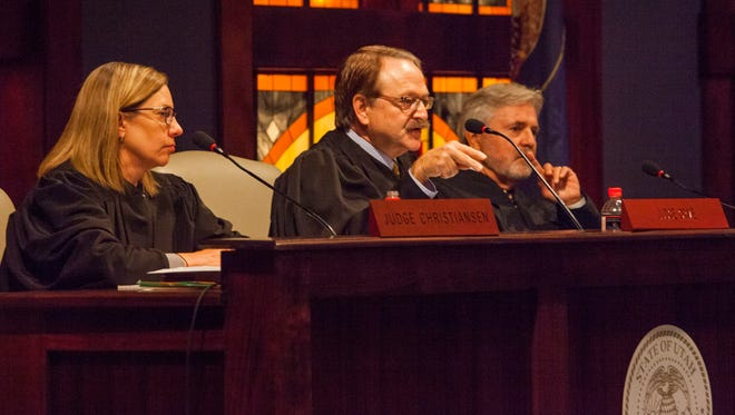 Judge Gregory K. Orme (center) speaks to the audience during a Southern Utah University Convocations with the Utah Court of Appeals, Thursday, Oct. 13, 2016.