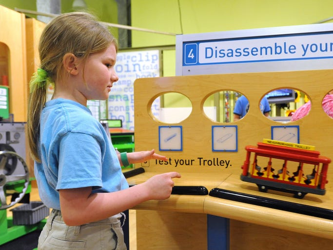 Elizabeth Welbourne, 7, of Huntsville, Ala., watches her trolly roll Sunday at the Mississippi Children's Museum's How People Make Things exhibiit in the Gertrude C. Ford Exhibition Hall at the museum in Jackson. The exhibit runs from June 7 through September 14.