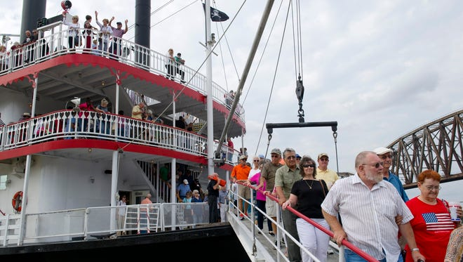 Passengers depart the Belle of Cincinnati riverboat for the Henderson Riverfront after a two-hour cruise on the Ohio River Wednesday afternoon.