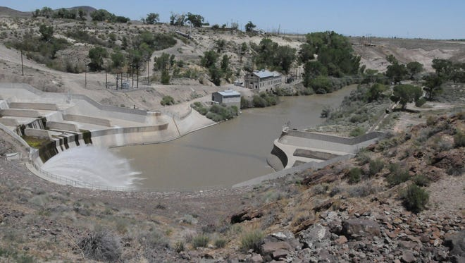 Water runs from the Lahontan Dam into the spillway to the Carson River during the celebration of the 100th anniversary of the construction of the dam.