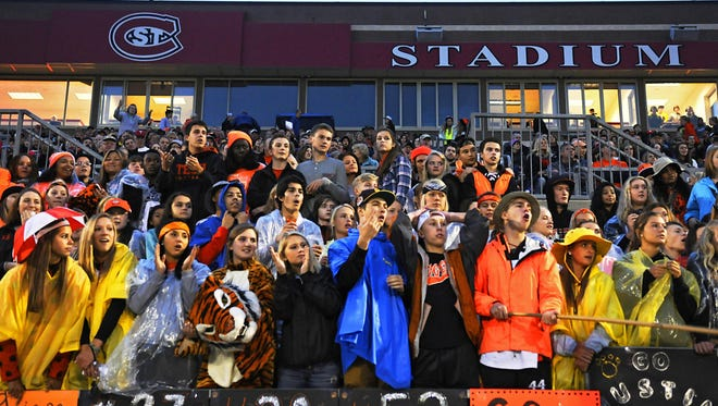 St. Cloud Technical High School students react to a call during the game against Sauk Rapids-Rice High School on Friday at Husky Stadium.
