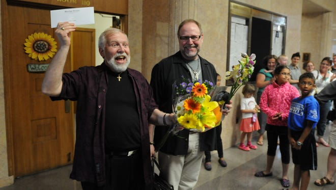 Allen Borgwardt and Bob Archer leave the Winnebago County Clerk's office after obtaining a marriage license on June 11. Gov. Scott Walker on Monday said the state will recognize same sex marriages performed in June.