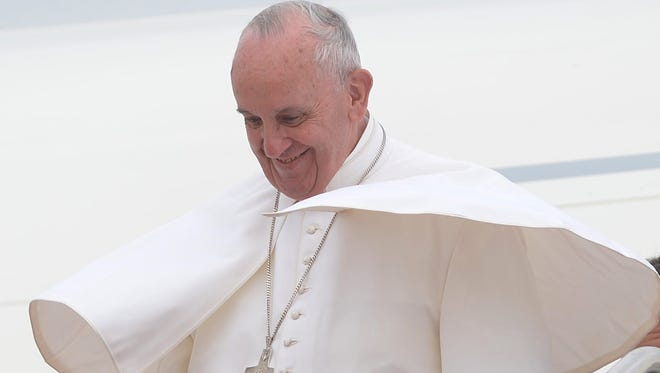 Pope Francis steps off his plane upon arrival at Andrews Air Force Base in Maryland on Tuesday, Sept. 22, 2015.
