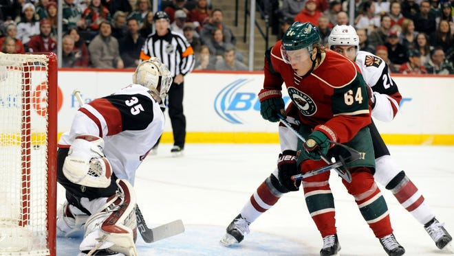 Jan 25, 2016: Minnesota Wild center Mikael Granlund (64) looks for a pass in front of the Arizona Coyotes net during the second period at Xcel Energy Center.