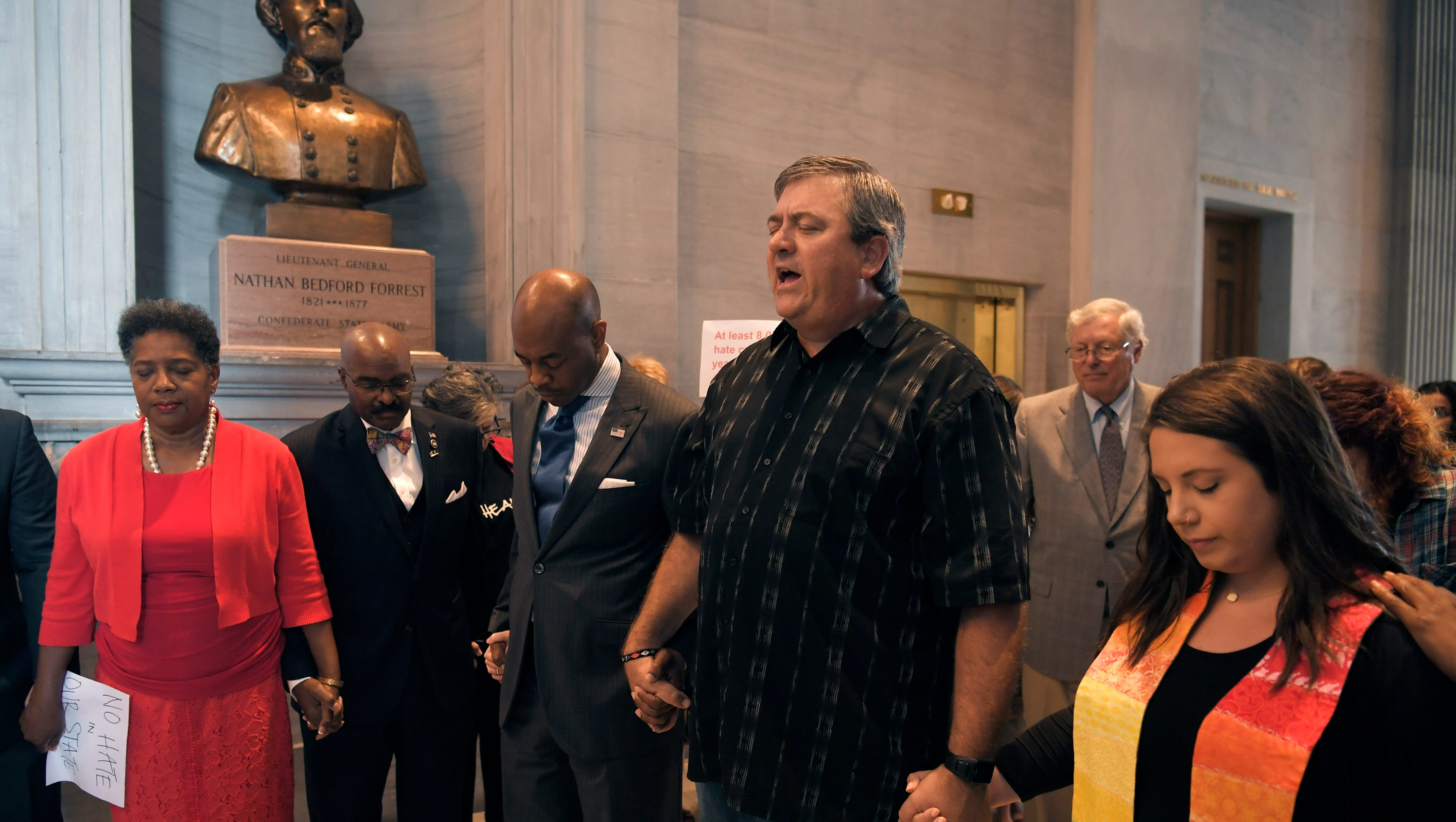 Local clergy, lawmakers and activists pray in front of bust of Nathan Bedford Forrest at the Tennessee Capitol on Monday, August 14, 2017. About 75 activists condemning white supremacy gathered in opposition to the bust of Nathan Bedford Forrest housed there.