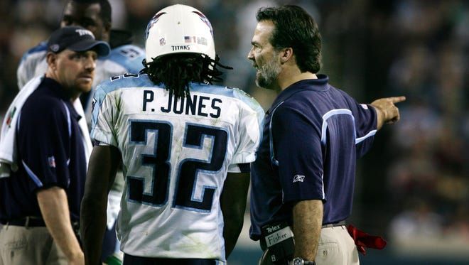 Coach Jeff Fisher tells cornerback Pacman Jones (32) to sit on the bench after Jones received an unsportsmanlike conduct penalty against the Jaguars in the last game of 2005 when the Titans finished 4-12.
