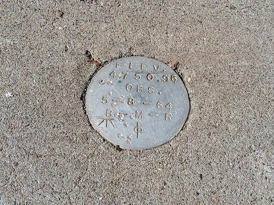 """A survey marker dated """"5-8-64"""" is seen at the Tortugas"""