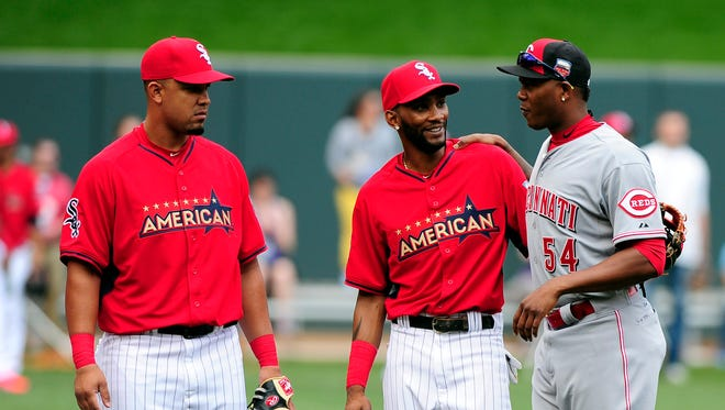 =National League pitcher Aroldis Chapman (54) of the Cincinnati Reds talks with American League infielder Alexei Ramirez (middle) and designated hitter Jose Abreu (left) of the Chicago White Sox before the 2014 MLB All Star Game at Target Field.