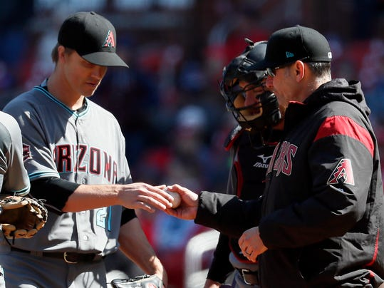 Arizona Diamondbacks starting pitcher Zack Greinke, left, is removed by manager Torey Lovullo, right, as catcher Jeff Mathis watches during the sixth inning of a baseball game against the St. Louis Cardinals, Saturday, April 7, 2018, in St. Louis. The Cardinals won 5-3. (AP Photo/Jeff Roberson)