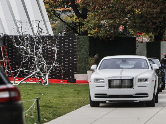 Rolls Royces and other luxury automobiles are parked on set of Batman vs. Superman at the Broad Art Museum in East Lansing early Thursday evening, Oct. 16, 2014, as workers set up a red carpet scene. Lansing State Journal file photo