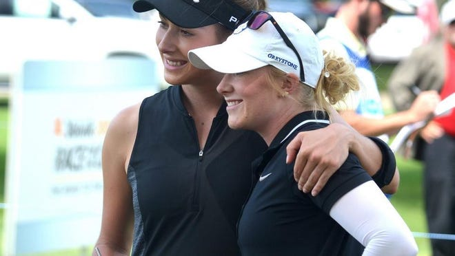 Gabrielle Shipley (left) and Sarah Shipley share a moment after last year's FireKeepers Casino Hotel Championship in Battle Creek.