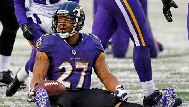 Dec 8, 2013: Baltimore Ravens running back Ray Rice (27) reacts after being tackled against the Minnesota Vikings at M&T Bank Stadium.