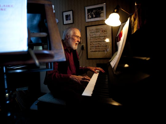 Robert DeCormier, founder of the Vermont Symphony Orchestra Chorus and Counterpoint Chorus, sits at his piano at his Belmont home in 2014.