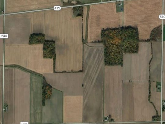 Aerial view of perimeter setup by authorities searching for a fugitive.