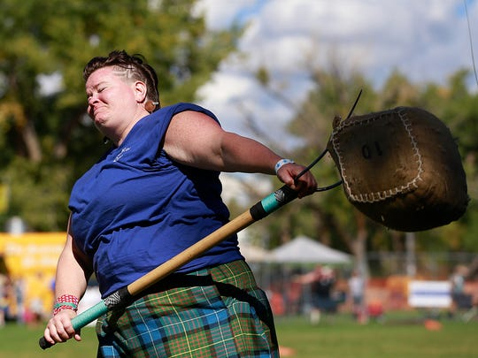 Becca Bishop, of Mesa, Ariz., competes in the sheaf toss during the Aztec Highland Games & Celtic Festival Saturday at Riverside Park in Aztec.