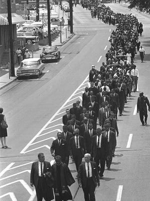 FILE - In this June 15, 1963 file photo, mourners march to the Jackson, Miss., funeral home following services for slain civil rights leader Medgar Evers. Several events are being held to remember Evers, the first Mississippi field secretary of the National Association for the Advancement of Colored People. He was 37 when he was assassinated outside the familyís north Jackson home on June 12, 1963. (AP Photo/file)